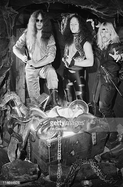 Heavy Metal band Venom posed with snakes and a treasure chest in London in October 1985. Left to right: drummer Anthony 'Abaddon' Bray, bassist...