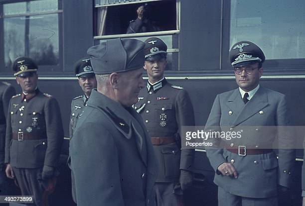 1st OCTOBER: Italian Prime Minister Benito Mussolini meets with Axis officers at the railway station in Florence, Italy during a visit by German...