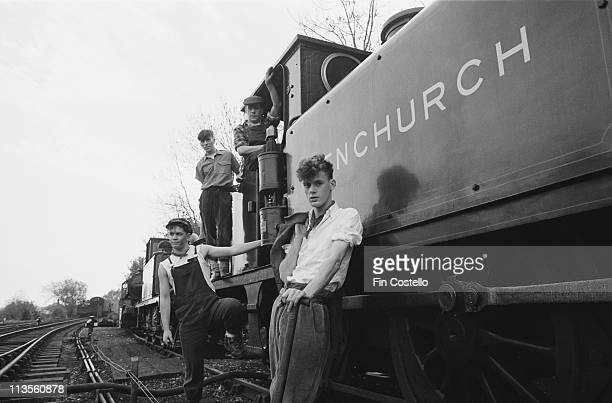 Liverpool band The Pale Fountains posed on and beside a steam engine on The Bleubell Railway in Sussex England in October 1982 The Pale Fountains are...