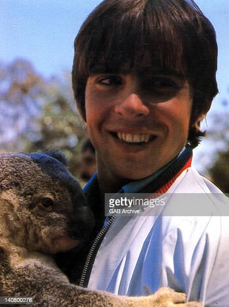 Photo of English actor singer and jockey Davy Jones holding a koala bear in Australia in 1968