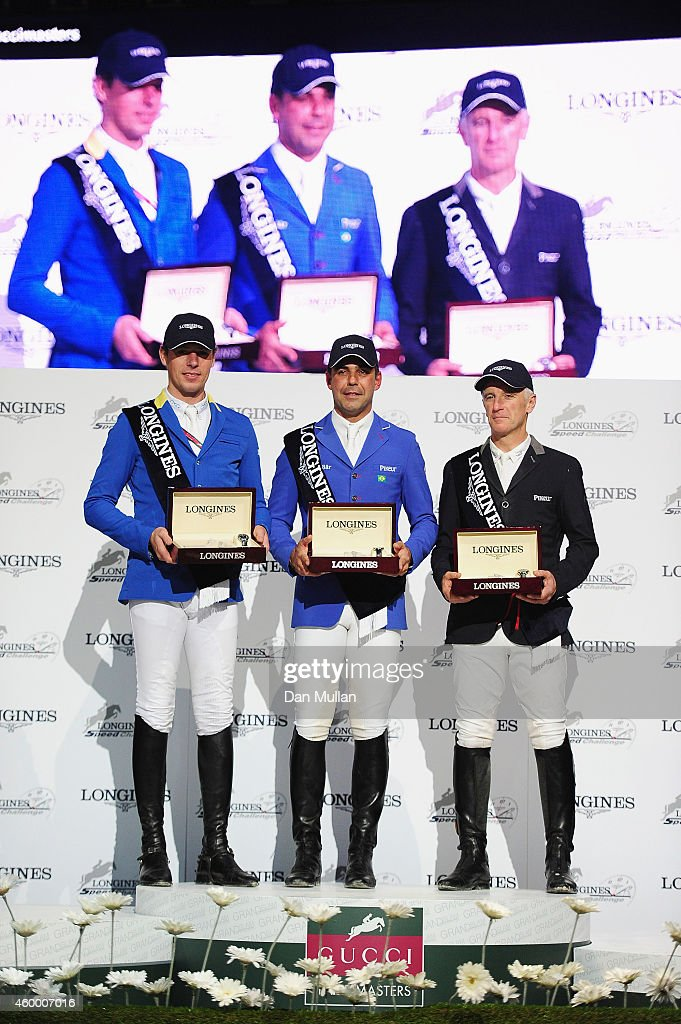 1st place finisher Doda de Miranda from Brazil (C), 2nd place finisher Christian Ahlmann from Germany (L) and 3rd place finisher Roger-Yves Bost from France (R) pose during the prize ceremony after the Longines Speed Challenge Prix class as part of the Gucci Paris Masters 2014 on December 5, 2014 in Villepinte, France.