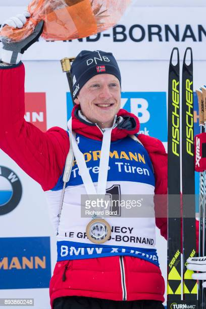 1st place Johannes Thingnes Boe of Norway poses on the podium after the IBU Biathlon World Cup Men's Pursuit on December 16 2017 in Le Grand Bornand...