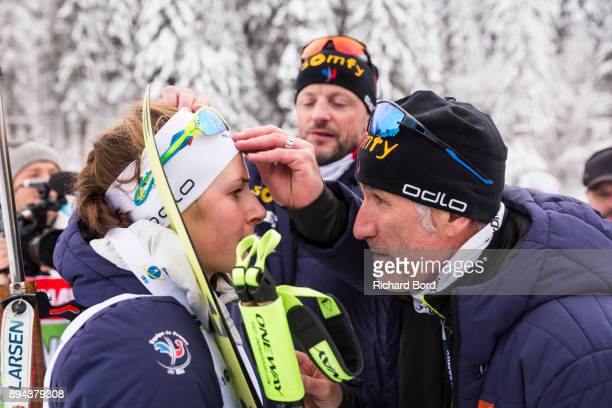 1st place Justine Braisaz of France and her coach Jean Paul Giachino are seen after the podium ceremony during the IBU Biathlon World Cup Women's...
