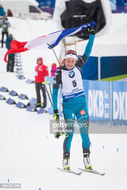 1st place Justine Braisaz of France celebrates as she passes the finish line during the IBU Biathlon World Cup Women's Mass Start on December 17 2017...