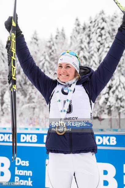1st place Justine Braisaz of France celebrates following the podium ceremony after the IBU Biathlon World Cup Women's Mass Start on December 17 2017...