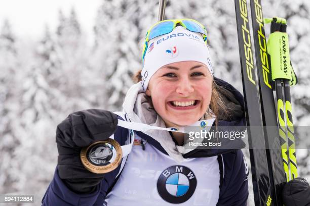1st place Justine Braisaz of France poses following the podium ceremony after the IBU Biathlon World Cup Women's Mass Start on December 17 2017 in Le...