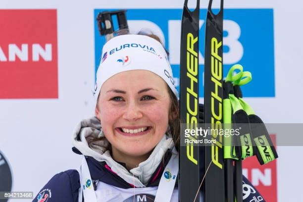 1st place Justine Braisaz of France poses on the podium ceremony after the IBU Biathlon World Cup Women's Mass Start on December 17 2017 in Le Grand...