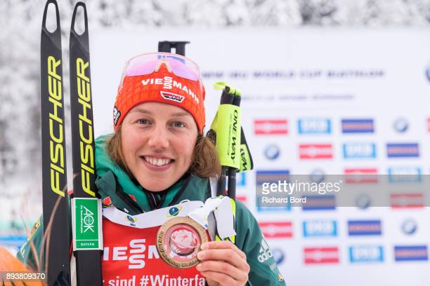 1st place Laura Dahlmeier of Germany poses following the podium ceremony after the IBU Biathlon World Cup Women's Pursuit on December 16, 2017 in Le...