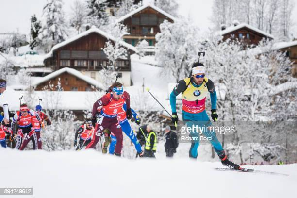 1st place Martin Fourcade of France and 4th place Anton Shipulin of Russia compete during the IBU Biathlon World Cup Men's Mass Start on December 17...