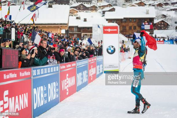 1st place Martin Fourcade of France celebrates prior the podium ceremony after the IBU Biathlon World Cup Men's Mass Start on December 17 2017 in Le...