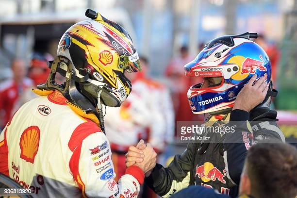 1st place Scott McLaughlin driver of the Shell V-Power Racing Team Ford Falcon FGX celebrates with 2nd place Jamie Whincup driver of the Red Bull...