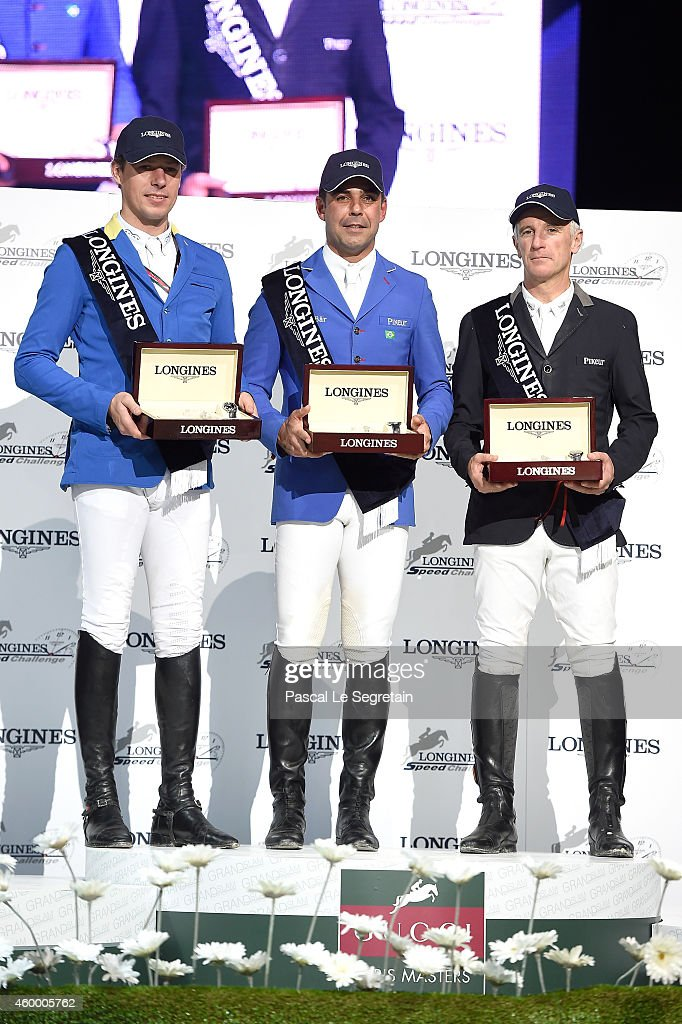 1st place winner Doda de Miranda from Brazil (C), 2nd place winner Christian Ahlmann from Germany (L) and 3rd place winner Roger-Yves Bost from France (R) pose during the award ceremony during the Longines Speed Challenge Prix class as part of the Gucci Paris Masters 2014 on December 5, 2014 in Villepinte, France.
