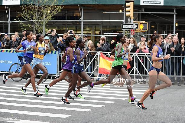 1st place winner from Kenya Mary Keitany with other marathon participants run through the streets of Manhattan during the TCS New York City Marathon...