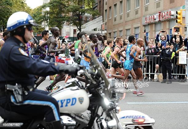 1st place winner from Kenya Stanley Biwott with other marathon participants run through the streets of Manhattan during the TCS New York City...