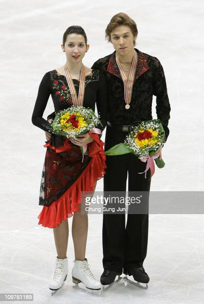 1st place winners Ksenia Monko and Kirill Khaliavin of Russia pose on the ice after the medals ceremony of the Ice Dance Free of the 2011 World...