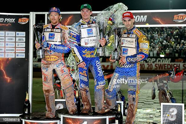 1st placed Rune Holta of Poland 2nd Jason Crump of Australia and 3rd Tomasz Gollob of Poland pose on the podium after the FIM Speedway Grand Prix of...