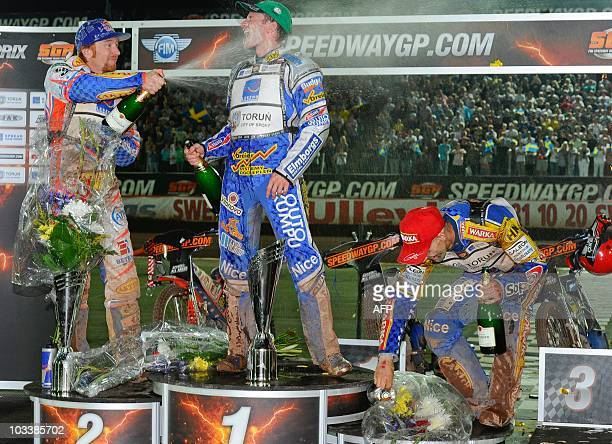 1st placed Rune Holta of Poland is sprayed with champagne by 2nd Jason Crump of Australia while 3rd Tomasz Gollob of Poland ducks after the FIM...