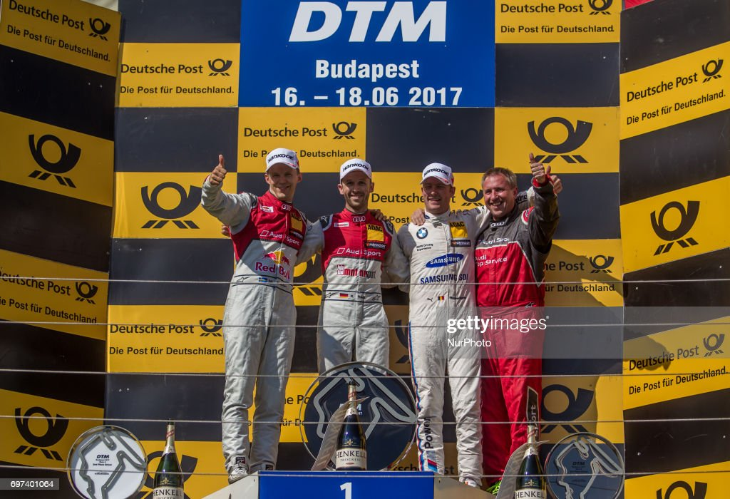 1st René Rast, 2nd Mattias Ekström and 3rd Maxime Martin standing on the podium after the Hungarian DTM race on June 18, 2017 in Mogyoród, Hungary.