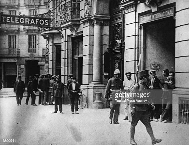 Soldiers walk past the telephone exchange during a Military Revolt in Barcelona Spain