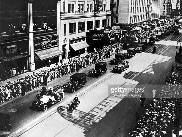 The funeral procession of Italianborn film actor Rudolph Valentino coming up Broadway New York