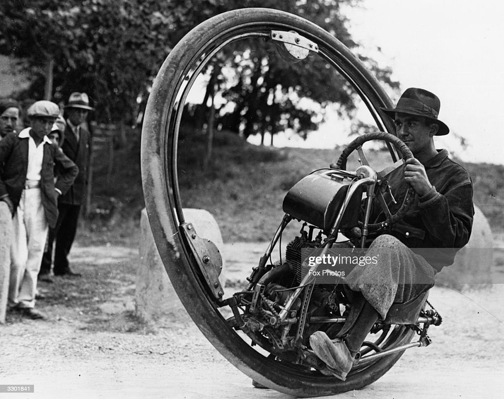 Swiss engineer M Gerder at Arles, France on his way to Spain in his 'Motorwheel', a motorcycle with a wheel which runs on a rail placed inside a solid rubber tyre.
