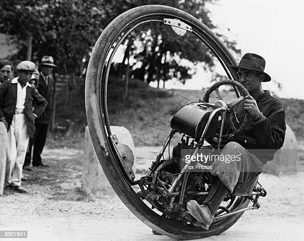 Swiss engineer M Gerder at Arles France on his way to Spain in his 'Motorwheel' a motorcycle with a wheel which runs on a rail placed inside a solid...