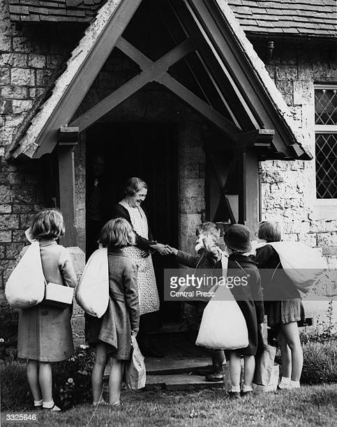 Evacuated children from London being welcomed at their billets in a Surrey village just before the start of WW II.