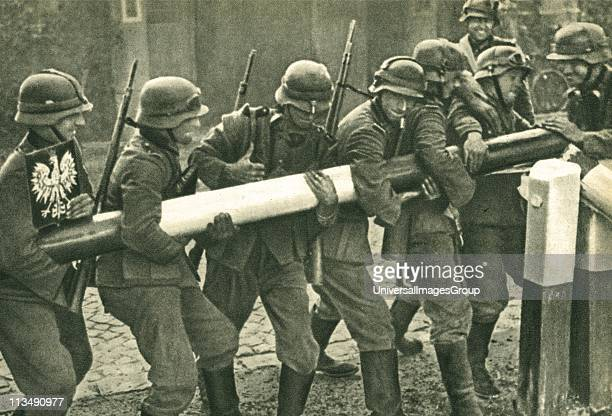 UNSPECIFIED 1st September 1939 German troops remove the border barrier between Poland and Germany during the invasion of Poland The Nazi occupation...