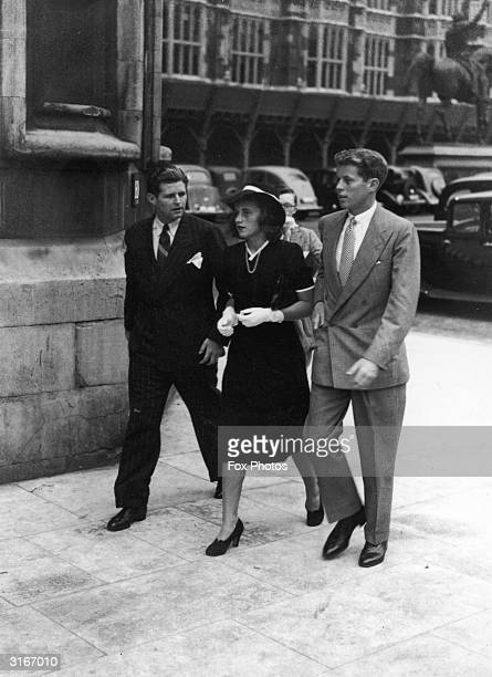 Joe, Kathleen and John F Kennedy, the children of American Ambassador to Great Britain, Joseph P Kennedy, arriving at the Houses of Parliament in...