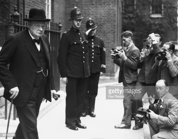 Press photographers catch Churchill leaving Downing Street London Decades 1826 069