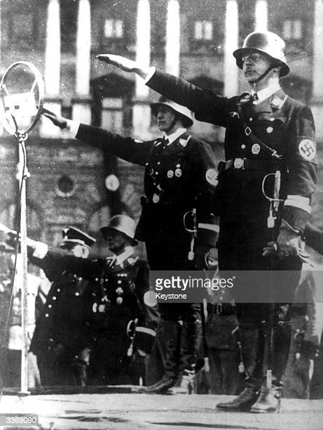 Nazi official Heinrich Himmler taking the salute at a parade he was later appointed head of all German Police Forces including the infamous Gestapo