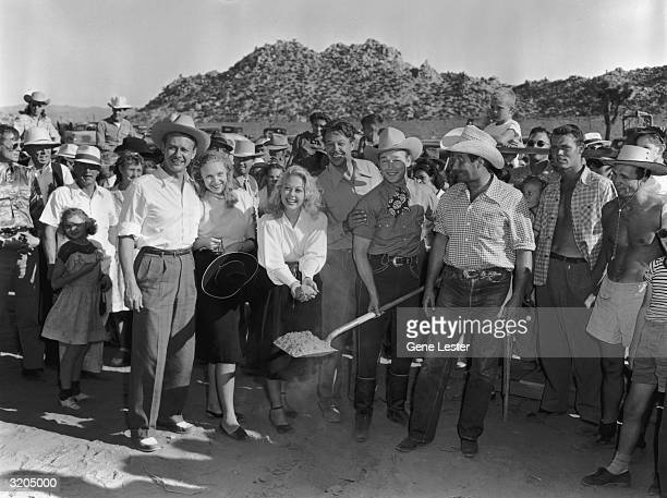 EXCLUSIVE The musical group Sons of the Pioneers David Bruce Sally Patten Adele Mara unknown man Roy Rogers and George Tobias Rogers is holding a...