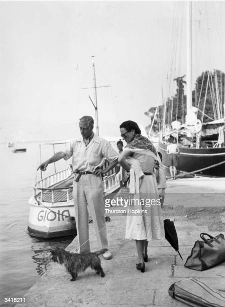 The Duke and Duchess of Windsor on the quayside at Portofino with their dog They are on a cruise in the Mediterranean on a yacht belonging to...