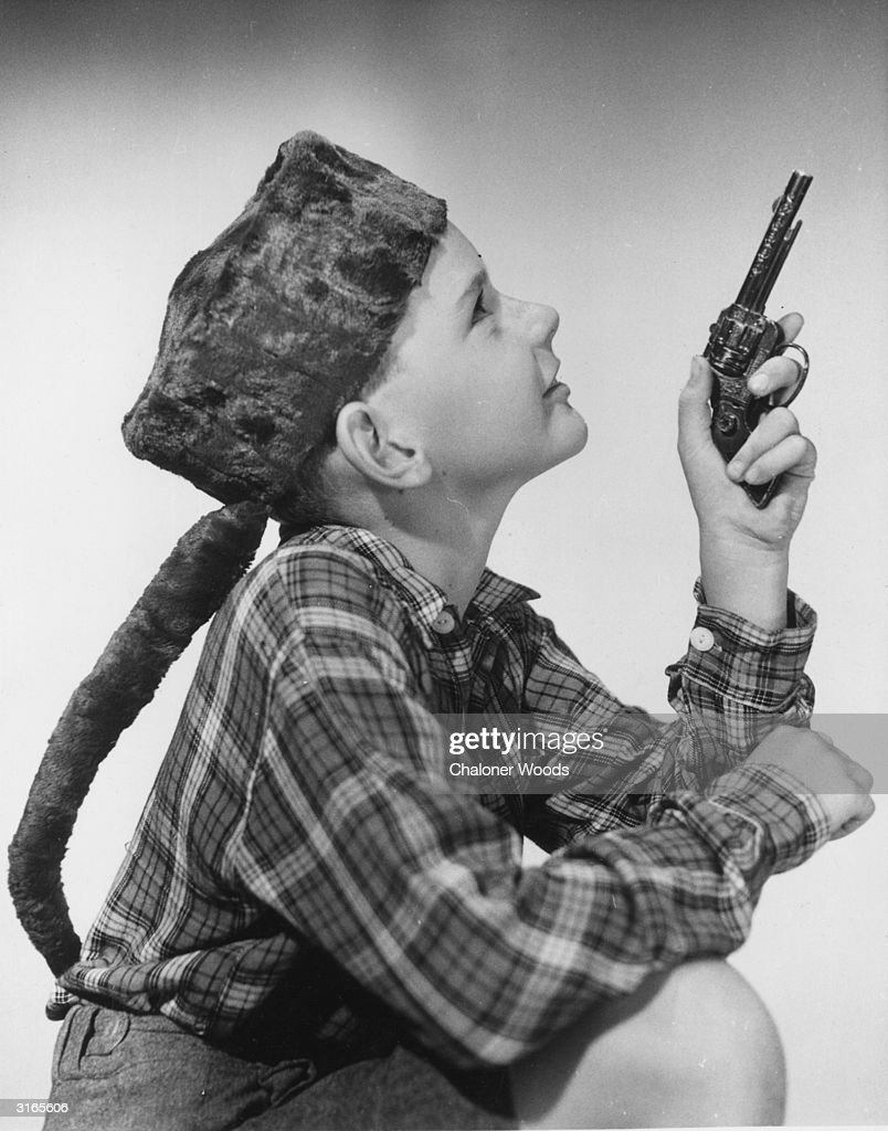 Image result for kid in davy crockett coonskin hat 1950s getty images
