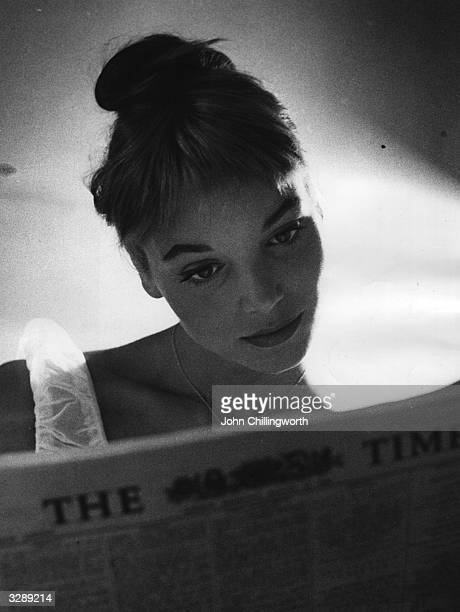 Italian actress and model Elsa Martinelli reading 'The Times' during a visit to London Original Publication Picture Post 8666 Elsa Decided British Is...