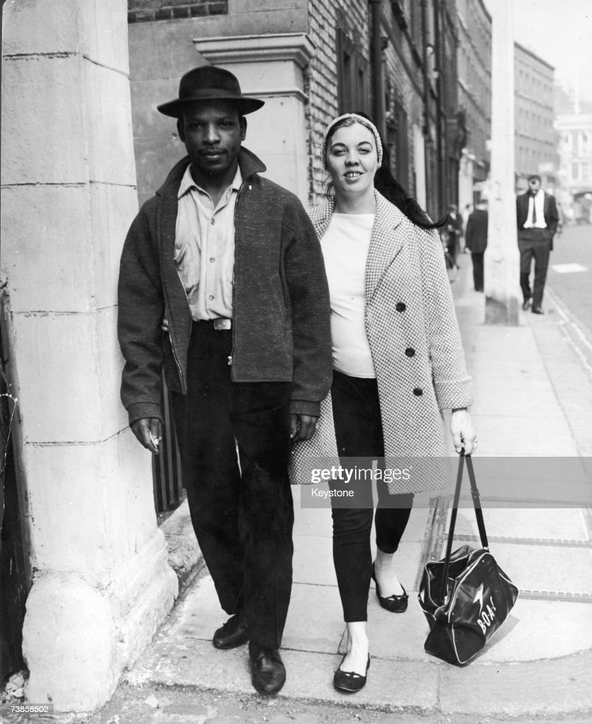 Maj-Britt Morrison leaves the West London Police Court with her husband Raymond, having been charged with obstruction during the Notting Hill race riot. She is to attend a special hearing at the Tower Hill Court in a few days' time.