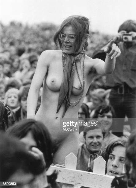 A naked woman dancing in the crowd at the Isle of Wight Festival in anticipation of the Bob Dylan concert