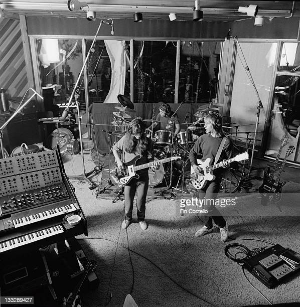 Canadian progressive rock band Rush recording their album 'Permanent Waves' at Le Studio Morin Heights Quebec Canada in October 1979 Left to right...