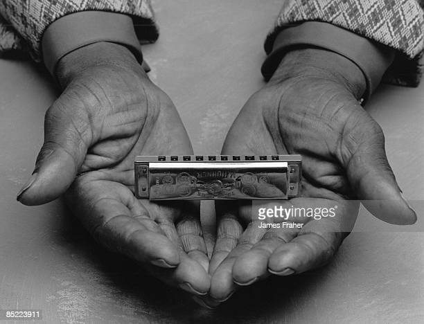 Photo of BLUES and HARMONICA Blues harmonica player holding his instrument in his hands in Chicago Illinois USA in September 1987