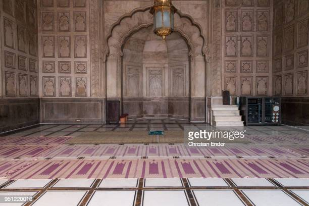 The interior of the Badshahi Mosque with several carpets that are laying on the ground on March 1st 2014 in Lahore Pakistan The mosque is an...