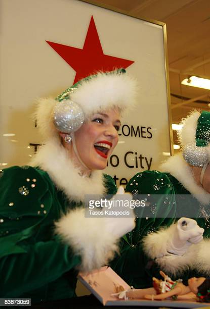 The Rockettes from Radio City Christmas Spectacular autograph Madame Alexander's Candy Cane Rockette doll at FAO Schwarz at Macy's on State street...