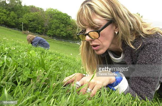 EllenRay Hennessy right searches for four leaf clovers with Charissa Wilcox on the hill in Riverdale Park Monday May 28 2001 Hennessy got an...