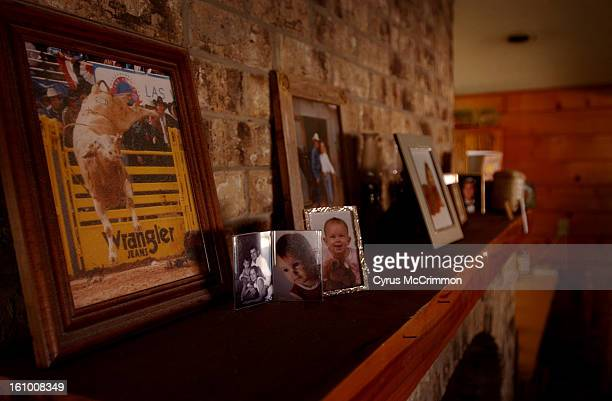 At the home of Sammy Andrews the owner of world famous bull Bodacious a photograph of the ferocious bull sits atop the mantle next to photos of...