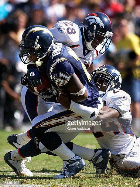 SAN DIEGO CA SEPTEMBER 14 2003Bronco safety Kenoy Kennedy and cornerback Deltha O'Neal team up to tackle Charger running back LaDainian Tomlinson...