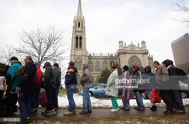 DENVER COLORADO DECEMBER 22 2003Needy individuals wait in line for a $2000 cash gift given out at the Cathedral of Immaculate Conception 1530 Logan...