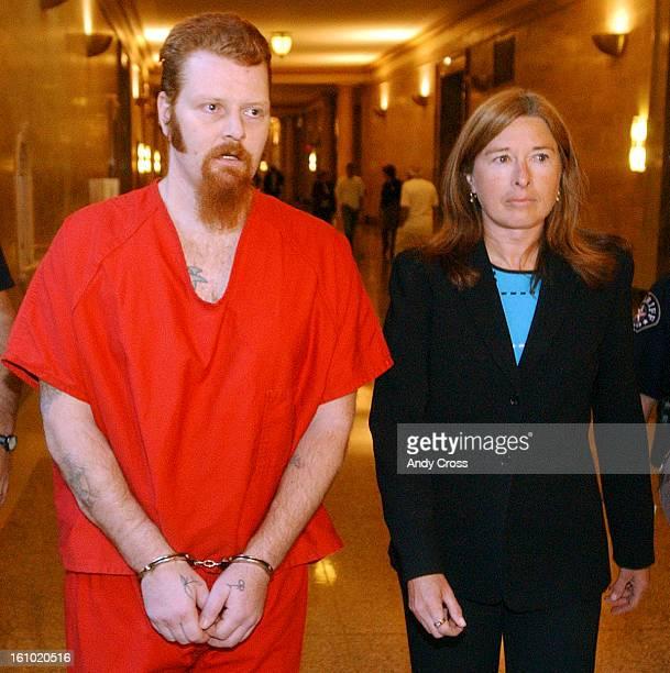 COJUNE 2ND 2004Attorney Sharlene <Cq> Reynolds <cq> walks with Selfprofessed serial killer Richard Paul White <cq> down a hallway of the Denver City...