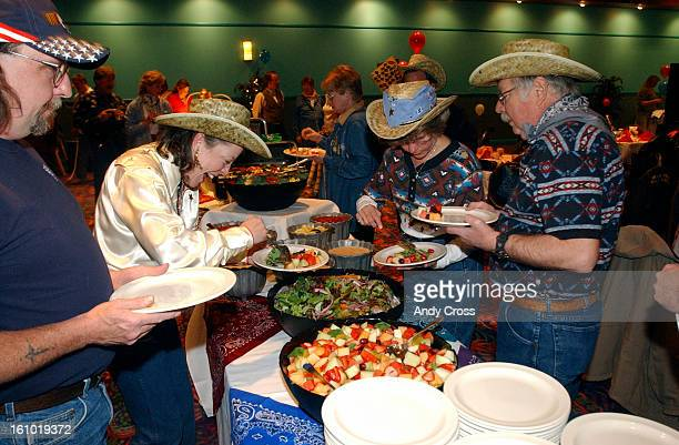 COAPRIL 30TH 2004Black Hawk residents line up and load up on food prepared buffet style during a party held for Black Hawk residents at the Isle of...