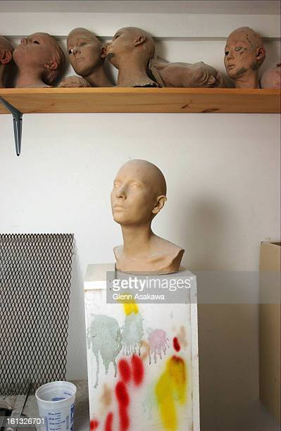 Busts of molds from previous works lie on shelves in the studio of John DeAndrea <cq> . John DeAndrea <cq> is the Colorado sculptor who created...