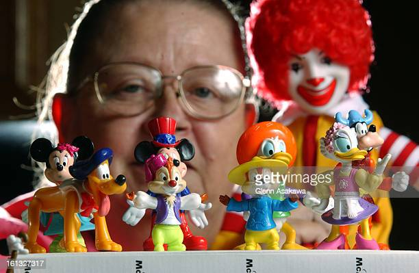 WESTMINSTER COLORADO JULY 12 2004Caron <cq> Lawless <cq> displays a just a small percentage of her total McDonald's Happy Meal figurine collection...