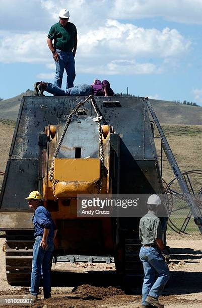 C0JUNE 7TH 2004Grand County Commissioner Duane <cq> Dailey <cq> left stands on top of the bulldozer used by Marvin <cq> Heemeyer <cq> in Friday's...